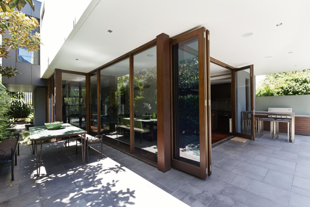 Large wooden Bi fold doors on ground floor of large modern home