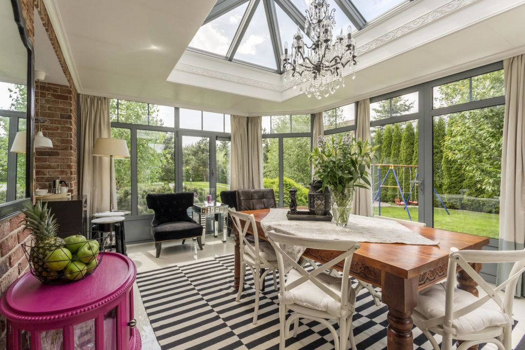 eccentric decorated sunroom area looking out to large garden
