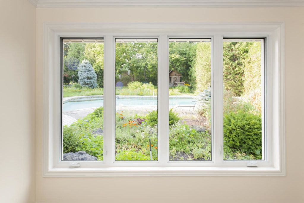 white upvc window looking out to garden and pond
