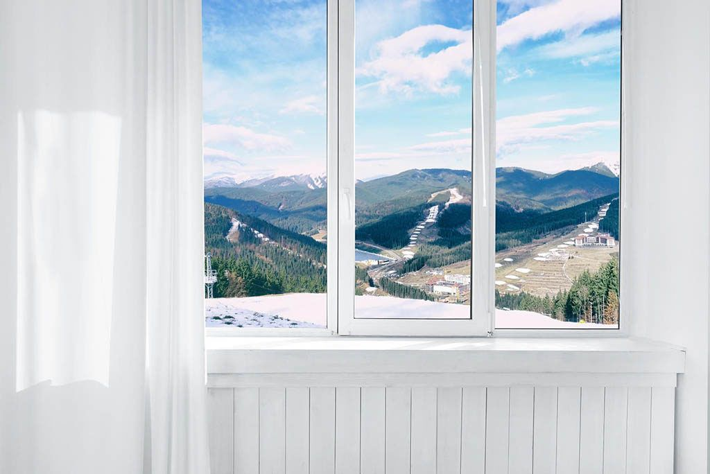 upvc window in white room overlooking mountains