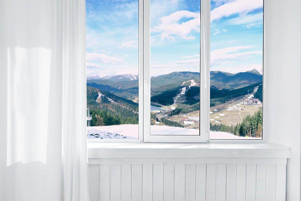 upvc window in white room overlooking mountains